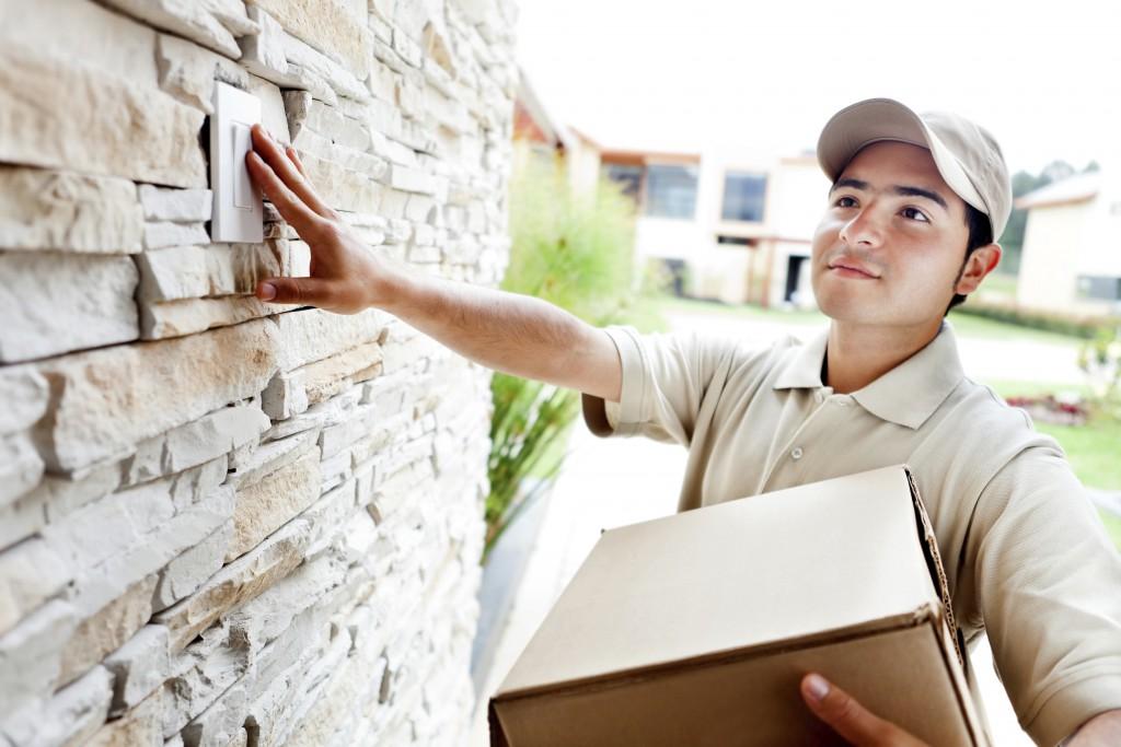 Delivery man ringing doorbell